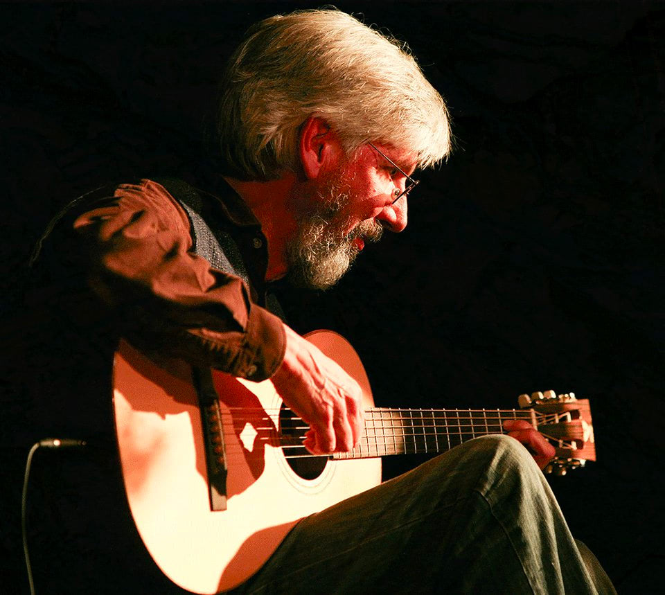 Nicholas Hooper plays guitar