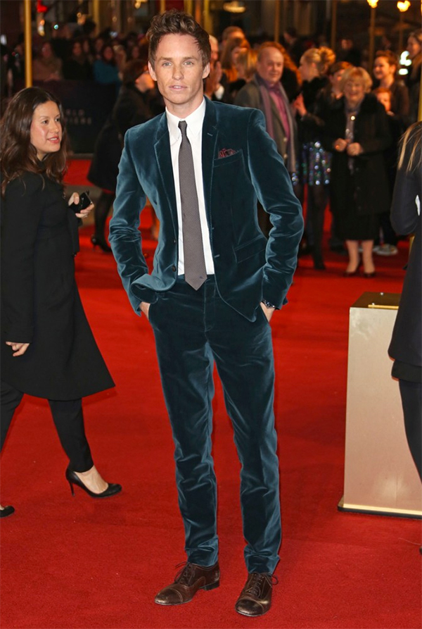 Eddie Redmayne (Newt) walks the red carpet at a premiere event